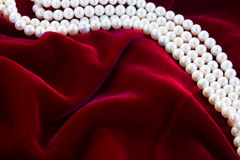 Red velvet background with pearls Royalty Free Stock Image