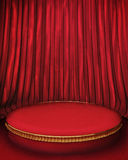 Red velvet background. A round dais framed by a red velvet curtain in the background Stock Photos