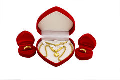 Red velvet box with golden ring and gold necklace Stock Images