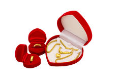 Red velvet box with golden ring and gold necklace Royalty Free Stock Photos