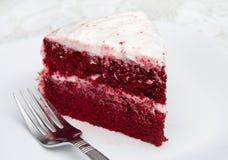 Red velvet cake. One slice of red velvet cake on a white plate with a fork Royalty Free Stock Image