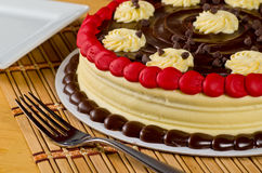 Red Velvet Cake. A Delicious Red Velvet Cake with Chocolate Frosting and Vanilla Swirls Stock Images