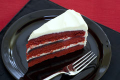 Red Velvet Cake. Piece of red velvet cake with cream cheese frosting Royalty Free Stock Photo