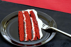 Red velvet cake. Slice of red velvet cake with chocolate and cream cheese frosting Royalty Free Stock Image