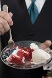 Red velvet cake being eaten royalty free stock photo