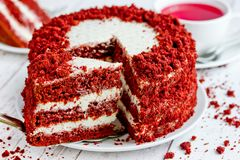 Red velvet cake, classic three layered cake from red butter sponge cakes with cream cheese frosting