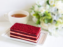 Red velvet cake and a cup of tea Stock Images