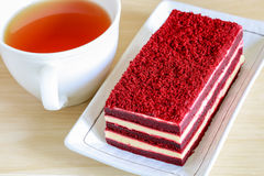 Red velvet cake and a cup of tea. On wooden table Stock Photography