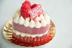 Red velvet cake decoration letter love. A red velvet cake decoration letter love Stock Photos