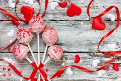 Red velvet cake pops for valentine day. Red velvet cake pops covered in white chocolate decorated with red and pink sugar sprinkles, sweet treats for valentine royalty free stock image