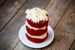 Red velvet cake. With silver piping on wooden background Royalty Free Stock Photo