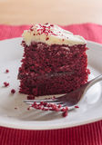 Red velvet cake slice with fork Stock Photos