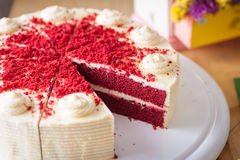 Red velvet cake. On wood table with morning scene Royalty Free Stock Photo
