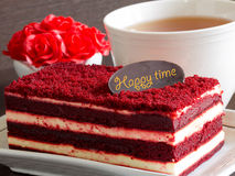 Red velvet cake on wood table and red roses Stock Images