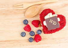 Red Velvet cake on wooden background, Shape of heart,raspberries. Stock Photography