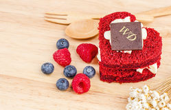 Red Velvet cake on wooden background, Shape of heart, raspberries. Stock Photography