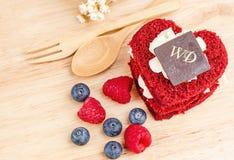 Red Velvet cake on wooden background, Shape of heart, raspberries. Stock Images