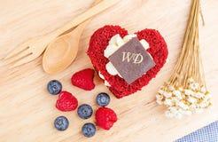 Red Velvet cake on wooden background, Shape of heart, raspberries. Stock Image