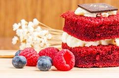 Red Velvet cake on wooden background, Shape of heart, raspberries. Stock Photo