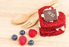 Red Velvet cake on wooden background, Shape of heart, raspberries. Royalty Free Stock Photo