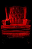 Red velvet chair Stock Photos
