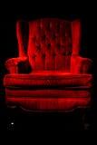 Red velvet chair. A red velvet chair isolated on black Stock Photos