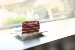 Red velvet chocolate cake on white plate valentine concept. Red velvet chocolate cake on white plate and beautyful bokeh for valentine royalty free stock photo