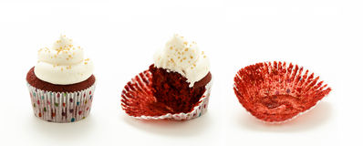 Red Velvet Cup Cakes. Line of red velvet cup cakes with white frosting going through three stages of being eaten Royalty Free Stock Images