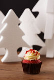 Red velvet cupcake on Christmas background Royalty Free Stock Image