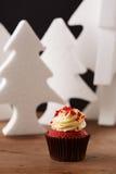 Red velvet cupcake on Christmas background Royalty Free Stock Image