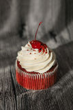 Red velvet cupcake decorated with vanilla cream on Stock Photo