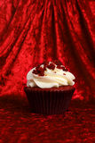 Red Velvet Cupcake on Red Velvet Background Stock Images