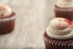 Red velvet cupcake on rustic table top Stock Photography