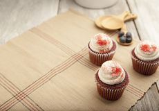 Red velvet cupcake on rustic table top Royalty Free Stock Photos