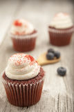 Red velvet cupcake on rustic table top Royalty Free Stock Image