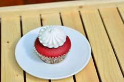 Red Velvet Cupcake. A red velvet cupcake with vanilla frosting Stock Photo