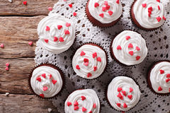 Red velvet cupcakes decorated with hearts close-up. horizontal t Stock Images