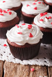 Red velvet cupcakes decorated with hearts close-up. vertical royalty free stock photo