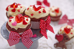 Red velvet cupcakes decorated with hearts Stock Images