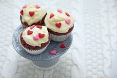 Red velvet cupcakes decorated with hearts Royalty Free Stock Photos