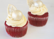 Red velvet cupcakes with icing. And decorations Royalty Free Stock Image