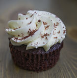 Red velvet cupcakes. On wooden background Royalty Free Stock Image
