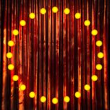 Red velvet curtain stage with neon lights Royalty Free Stock Images