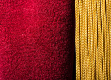 Red velvet curtain with tassel Royalty Free Stock Image