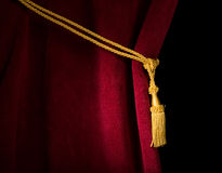 Red velvet curtain with tassel Stock Images