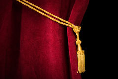 Red velvet curtain with tassel royalty free stock photos