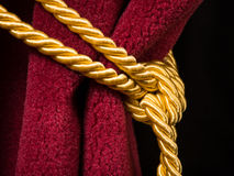 Red velvet curtain with tassel Stock Image