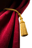 Red velvet curtain with tassel Stock Photography