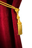 Red velvet curtain with tassel Stock Photo