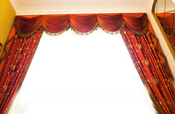 Red velvet curtains Stock Images